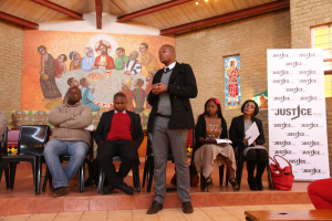 Lehlohonolo Mashifane Candidate Attorney at Legal Aid South Africa addresses the community. (photograph by Mfuneko Toyana)