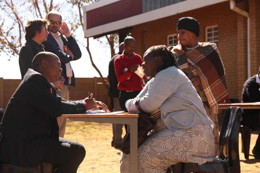Osmond Mngomezulu of Pro-Bono providing community members with free legal advice at the clinic after the discussion event (photograph by Mfuneko Toyana)